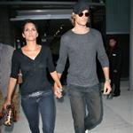 Halle Berry and Gabriel Aubry arrive at an event finger linking hands 44349
