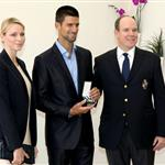 Prince Albert of Monaco and Princess Charlene present tennis champ Novak Djokovic with the Vermeil Sport Medal of Monaco for Physical Education and Sports during The Monte Carlo Rolex Masters  111432