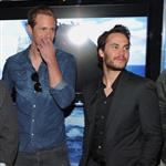 Taylor Kitsch and Alexander Skarsgard get a look at the Deluxe Battleship Movie Edition game while visiting Hasbro's American International Toy Fair showroom in New York 106120