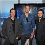 Taylor Kitsch and Alexander Skarsgard get a look at the Deluxe Battleship Movie Edition game while visiting Hasbro's American International Toy Fair showroom in New York along with director Peter Berg 106125