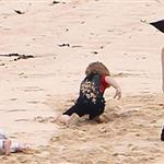 Angelina Jolie with Knox, Vivienne, and Shiloh on the beach in the Galapagos Islands 112014