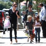 Angelina Jolie with a skipping Zahara and Shiloh buying costumes 90097