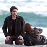 Wes Bentley and Christian Bale play in the surf filming on Santa Monica Beach 110587