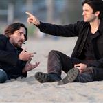 Wes Bentley and Christian Bale play in the surf filming on Santa Monica Beach 110589