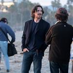 Wes Bentley and Christian Bale play in the surf filming on Santa Monica Beach 110597