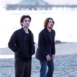 Wes Bentley and Christian Bale play in the surf filming on Santa Monica Beach 110599