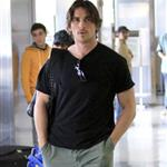 Christian Bale with his wife and daughter at LAX yesterday en route to New York to continue work on The Dark Knight Rises 97172