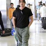 Christian Bale with his wife and daughter at LAX yesterday en route to New York to continue work on The Dark Knight Rises 97173