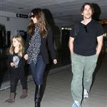 Christian Bale with his wife and daughter at LAX yesterday en route to New York to continue work on The Dark Knight Rises 97177