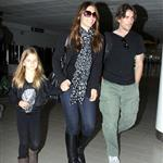 Christian Bale with his wife and daughter at LAX yesterday en route to New York to continue work on The Dark Knight Rises 97178