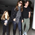 Christian Bale with his wife and daughter at LAX yesterday en route to New York to continue work on The Dark Knight Rises 97179