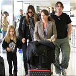 Christian Bale with his wife and daughter at LAX yesterday en route to New York to continue work on The Dark Knight Rises 97183