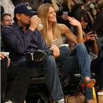 Leonardo DiCaprio covers his mouth with Bar Rafaeli at Laker playoff game  59788