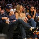 Leonardo DiCaprio covers his mouth with Bar Rafaeli at Laker playoff game  59789