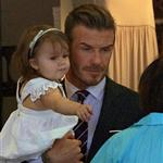 David Beckham holds Harper as they leave 202 restaurant in Notting Hill  121823