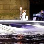 David Beckham passes under Tower Bridge driving a speedboat which carries the Olympic Torch carried by torchbearer Jade Bailey in London 121867