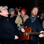 Bono and Glen Hansard busking for charity in Dublin on Christmas Eve 101368