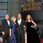 Angelina Jolie and Brad Pitt pose with Brad Pitt's parents Jane and William Pitt as they arrive on the red carpet for the 84th Annual Academy Awards 120050