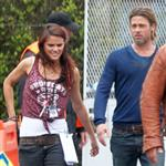 Brad Pitt chats with an attractive PA while on World War Z set 90178