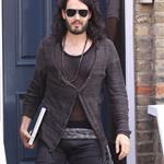 Russell Brand in shiny jights and flipflops leaving his home in London  36313