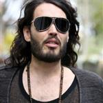 Russell Brand in shiny jights and flipflops leaving his home in London  36305