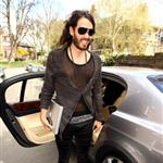 Russell Brand in shiny jights and flipflops leaving his home in London  36307
