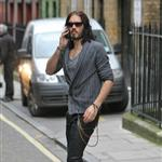 Russell Brand not wearing wedding ring in London after not spending holidays with Katy Perry  101490