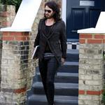 Russell Brand in shiny jights and flipflops leaving his home in London  36309