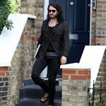 Russell Brand in shiny jights and flipflops leaving his home in London  36310