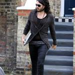 Russell Brand in shiny jights and flipflops leaving his home in London  36312