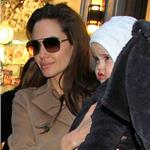 Angelina Jolie and Brad Pitt take twins to art store in New York to help promote The Tourist  74208