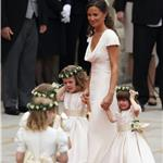 Sister of the bride and Maid of Honour Pippa Middleton holds hands with Grace Van Cutsem and Eliza Lopes as they arrive for the Royal Wedding 84075
