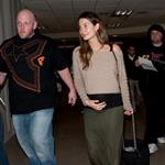 Caleb Followill and pregnant wife Lily Aldridge make their way through LAX 105337