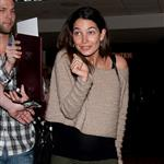 Caleb Followill and pregnant wife Lily Aldridge make their way through LAX 105348