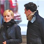 Carey Mulligan and Marcus Mumford walk through an office building in New York  101968