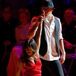 Channing Tatum and Jenna Dewan perform on stage at the Revlon concert for the Rainforest Fund at Carnegie Hall  110553