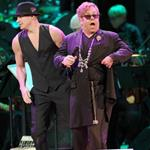 Channing Tatum and Elton John perform on stage at the Revlon concert for the Rainforest Fund at Carnegie Hall  110564