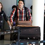 Charlie Hunnam catches a flight in Toronto 111726