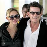 "Charlie Sheen with one of the ""goddesses"" yesterday at Live Nation declaring victory with a machete and a bottle of Tiger Blood after getting fired  80946"