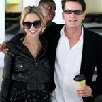 "Charlie Sheen with one of the ""goddesses"" yesterday at Live Nation declaring victory with a machete and a bottle of Tiger Blood after getting fired  80947"