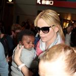 Charlize Theron makes her way through the airport in Paris with her son Jackson 113949