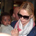 Charlize Theron makes her way through the airport in Paris with her son Jackson 113952