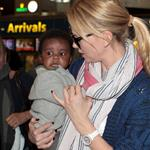 Charlize Theron makes her way through the airport in Paris with her son Jackson 113954