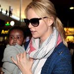 Charlize Theron makes her way through the airport in Paris with her son Jackson 113955