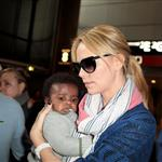 Charlize Theron makes her way through the airport in Paris with her son Jackson 113957