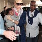 Charlize Theron makes her way through the airport in Paris with her son Jackson 113959