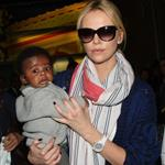 Charlize Theron makes her way through the airport in Paris with her son Jackson 113961