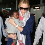Charlize Theron makes her way through the airport in Paris with her son Jackson 113963