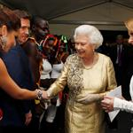 Queen Elizabeth II is introduced to Cheryl Coleby Kylie Minogue backstage after the Diamond Jubilee, Buckingham Palace Concert 116817