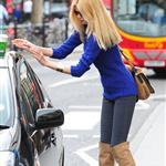 Claudia Schiffer in tall suede boots grabbing coffee in London 87446